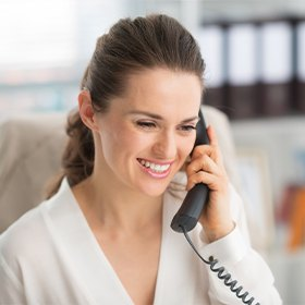 Smiling woman answering the phone
