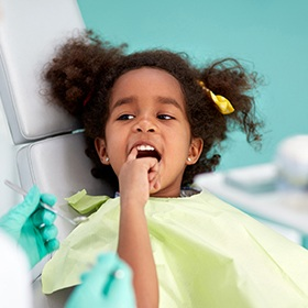 Child pointing at her tooth