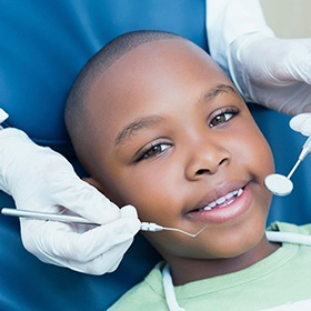 little boy visiting children's dentist in Goode
