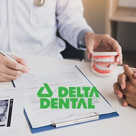Delta Dental insurance logo over insurance forms
