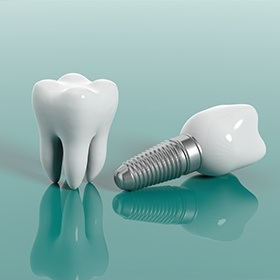dental implant with crown next to a natural tooth