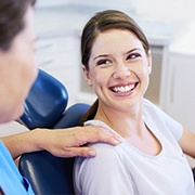 smiling woman in the dental treatment chair