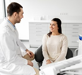 Patient and dentist discussing smile makeover treatment plan