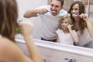 Your family dentist in Goode instructs on proper teeth brushing.