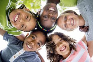 five kids huddled together