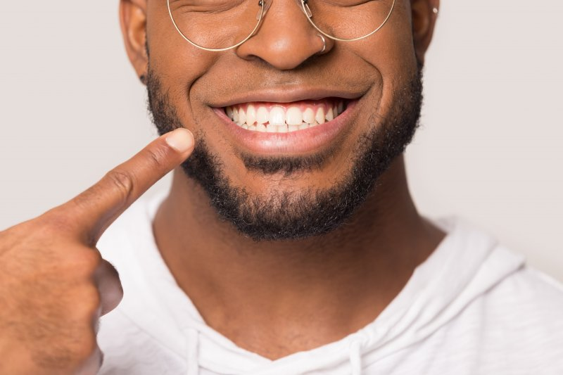 man smiling showing off white teeth