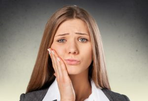 Woman with jaw pain on one side